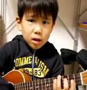 Uke3453 the little kid with the ukulele singing I'm Yours